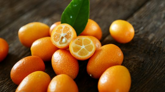 Kumquat fruits on old wooden table